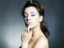 Beautiful woman with bright makeup and manicure Stock Images