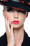 Beautiful woman with bright red lips. Close-up face of beautiful woman with bright red lips and fingernails in the fashion hat Royalty Free Stock Photo