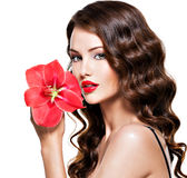 Beautiful woman with bright red lips and flower near the face Royalty Free Stock Photography