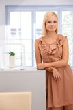 Beautiful woman in bright smart room Stock Image
