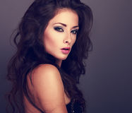 Beautiful woman with bright smokey makeup eyes and pink lipstick Royalty Free Stock Images