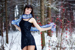 Beautiful woman with bright tinsel in winter forest Royalty Free Stock Photo