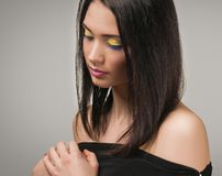 Beautiful woman with bright yellow make-up Royalty Free Stock Photo