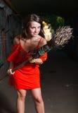 Beautiful woman with broom. Beautiful woman threatens broom in dark gateway Stock Photography