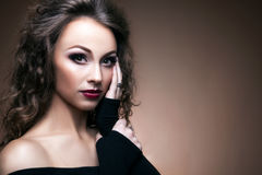 Beautiful woman on brow background toned skin Royalty Free Stock Images