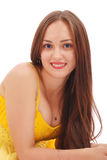 Beautiful woman with brown hair in elegant yellow dress royalty free stock photos