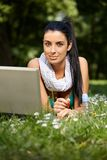 Beautiful woman browsing internet in citypark Stock Images