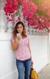 Beautiful woman browsing internet on smart phone Stock Photo
