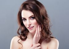 Beautiful Woman Brunette Red Lips Healthy Beauty Skin Smile. Spa stock photo
