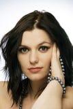 Beautiful woman brunette thinking Royalty Free Stock Photography