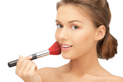 Beautiful woman with brush Royalty Free Stock Photos