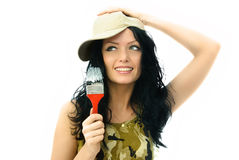 Beautiful woman with a brush Royalty Free Stock Image