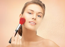 Beautiful woman with brush Stock Images