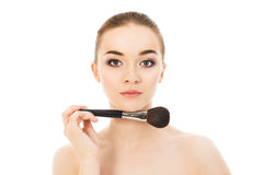 Beautiful woman with a brush for makeup isolated. Beautiful woman with a brush for makeup Royalty Free Stock Image