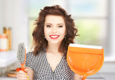 Beautiful woman with brush and pan Stock Photography