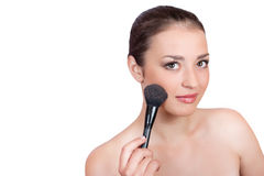 Beautiful woman with a brush rouge Royalty Free Stock Photo