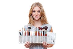 Beautiful woman with brushes for make-up Stock Photo