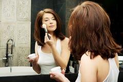 Beautiful woman brushing her cheek. Royalty Free Stock Image