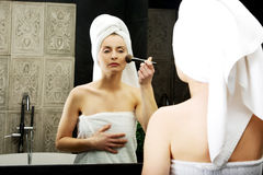 Beautiful woman brushing her cheek. Royalty Free Stock Photography