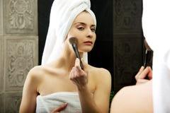Beautiful woman brushing her cheek. Royalty Free Stock Images