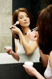 Beautiful woman brushing her cheek. Royalty Free Stock Photo
