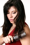 Beautiful woman brushing her hair Royalty Free Stock Image
