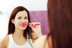 Beautiful woman brushing her teeth. Royalty Free Stock Photos