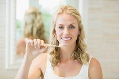 Beautiful woman brushing her teeth Royalty Free Stock Image