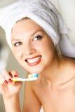 Beautiful woman brushing teeth Stock Image