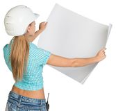 Beautiful woman builder holding in front of him Stock Photography