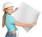 Beautiful woman builder looking at camera and Royalty Free Stock Photos