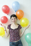 Beautiful woman with a bunch of balloons Royalty Free Stock Image
