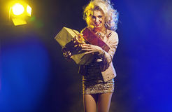 Beautiful woman with bunch of gifts royalty free stock image