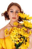 Beautiful woman with a bunch sunflowers. Stock Image