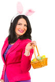 Beautiful woman with bunny ears holding basket Stock Photos