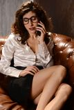 Beautiful woman in business outfit with smartphone Royalty Free Stock Photos