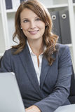 Beautiful Woman or Businesswoman in Office Stock Image