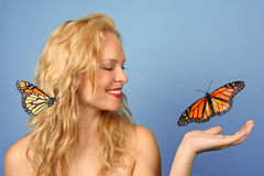 Beautiful Woman With Butterflies in Her Hand and H stock photography