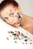 Beautiful woman with buttons on her face Stock Photos