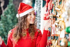 Beautiful Woman Buying Christmas Ornaments At Stock Photos