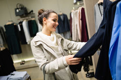 Beautiful woman buying clothes Stock Images