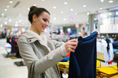 Beautiful woman buying clothes Stock Photo
