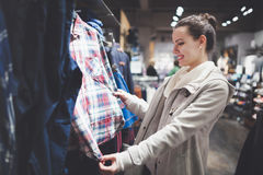 Beautiful woman buying clothes Royalty Free Stock Photos