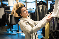 Beautiful woman buying clothes Stock Image