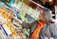 Beautiful woman buying mushrooms Stock Image
