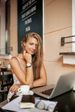 Beautiful woman in cafe with laptop Royalty Free Stock Photography