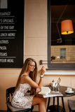Beautiful woman in cafe with laptop Royalty Free Stock Image
