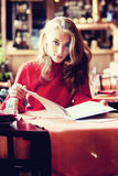 Beautiful woman in cafe Royalty Free Stock Image