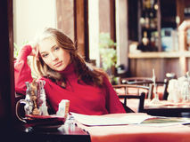 Beautiful woman in cafe Royalty Free Stock Images