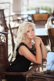 Beautiful woman in cafe restaurant, girl in bar, summer vacation. Pretty blond at breakfast. happy smiling woman Royalty Free Stock Photography